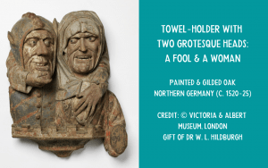 Wooden carved fool's head towel holder